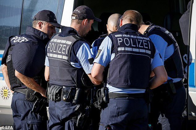 Around 100 officers (pictured) are combing Germany's Black Forest with the help of special forces, helicopters and sniffer dogs in the search