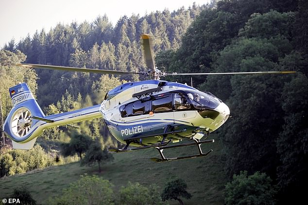 Nobody was injured in the incident close to Germany 's border with France. Pictured: A helicopter taking part in the man hunt