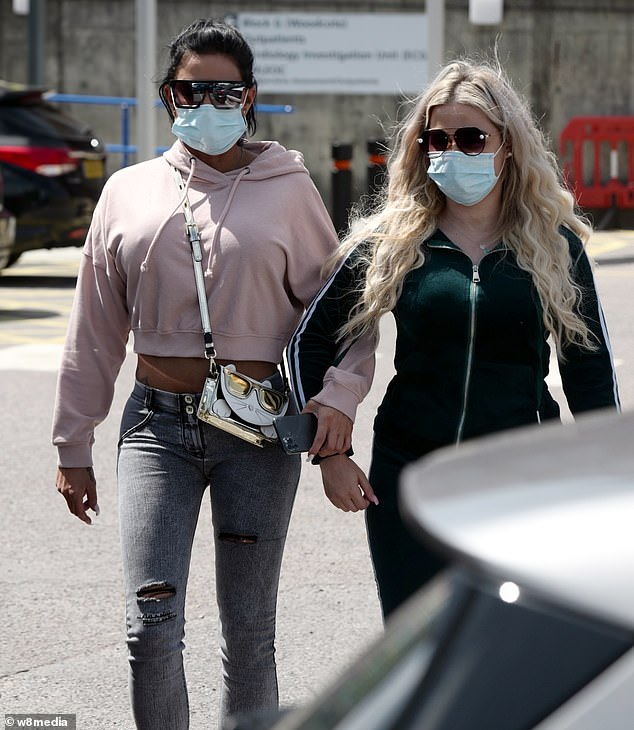 Comfort:Katie was comforted by her female friend after breaking down in tears outside the hospital entrance