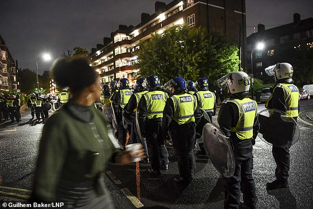 Pictured: Riot police attend an unlicensed music event in White City, west London on July 3