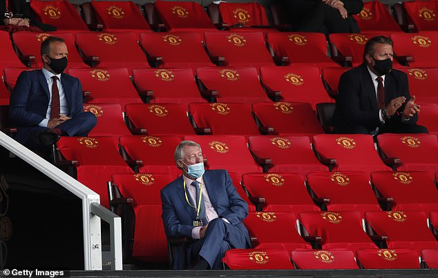 Ferguson sat socially distanced under Executive Vice President Ed Woodward in the stands