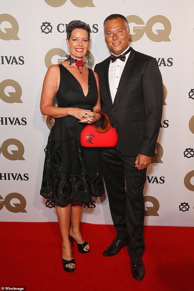 Grant resigned as a Seven presenter in 2000, weeks before the Sydney Olympics, after his affair with the commercial network's sports commentator Tracey Holmes was revealed. They later married and are pictured at the GQ Men of the Year awards in 2016