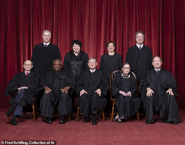 Ginsberg (front, second from right) is a staunchly liberal vote on the nine-member court