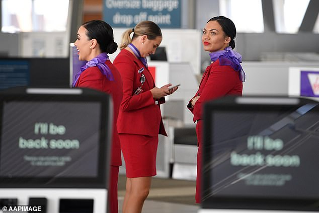 Administrators of Virgin Australia were forced to secure loans to pay employees of the embattled airline because the business had no money (pictured, staff at Sydney Airport)