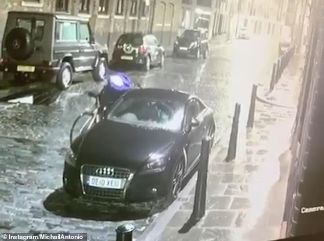 The cyclist is seen on CCTV approaching a Black Audi in the streets of Wapping, London