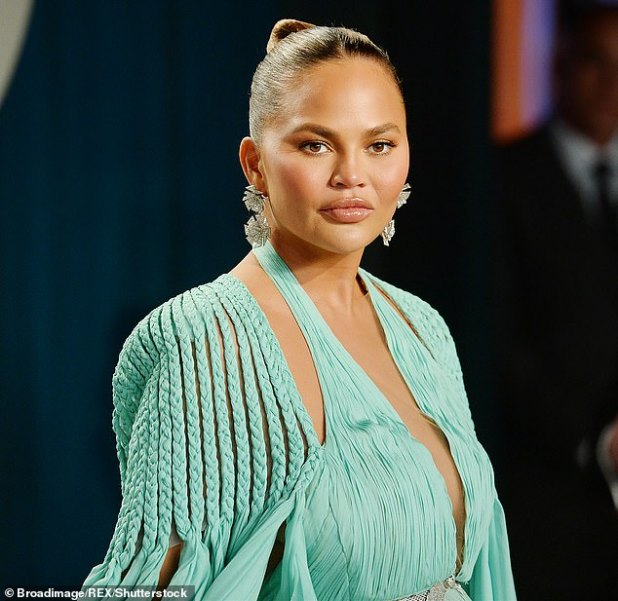 Tough times: Chrissy Teigen revealed that her account has been blocked by more than a million people on Twitter after she was 'flooded by sick psychiatrists' due to a wild conspiracy theory.