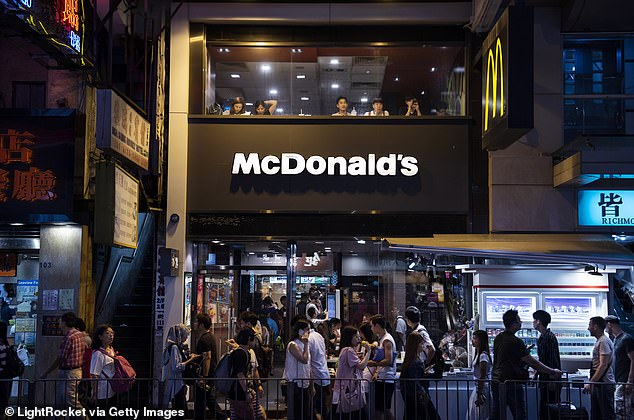 A McDonald¿s spokesperson told the local media that the company would continue to comply with the government¿s anti-virus measures following the city's new surge of cases. The file picture taken in 2018 shows customers eating at a McDonald's restaurant in Hong Kong