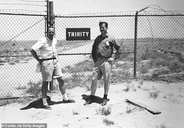 Above, two scientists stand outside the gate of Trinity base camp that was built in the unforgiving desert landscape outside Alamogordo, New Mexico. The location was carefully selected by Army generals to ensure the least damage from nuclear fallout