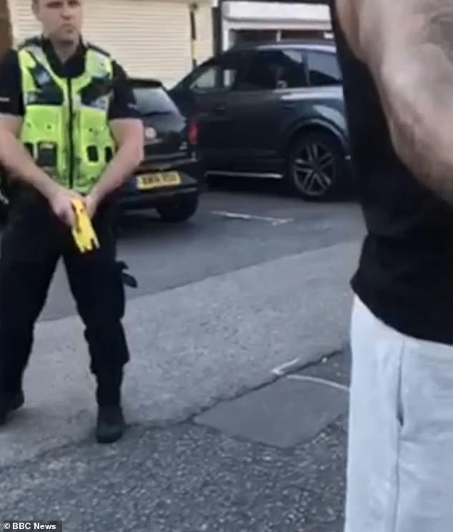 This is the moment Bristol City footballerBen Richards-Everton, right, had a Taser drawn on him during a stop and search in Sutton Coldfield, West Midlands