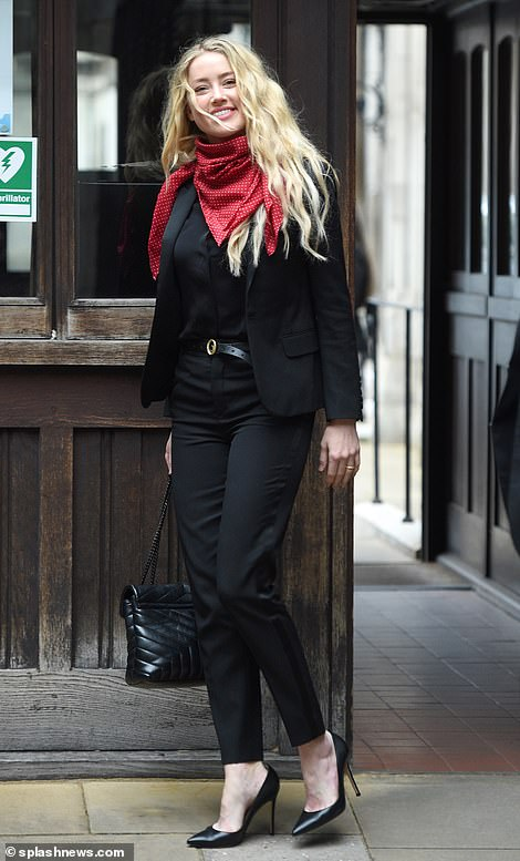 Amber Heard arrives at the Royal Courts of Justice today