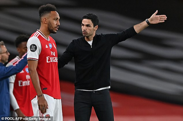 Arsenal boss Mikel Arteta (right) disagreed with Aubameyang (left) about the high tackle