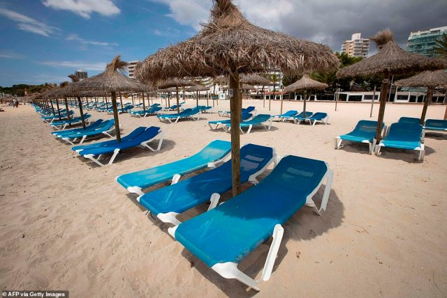 Empty deck chairs are pictured at Magaluf beach, Calvia, in Spain's Balearic island of Majorca on July 16