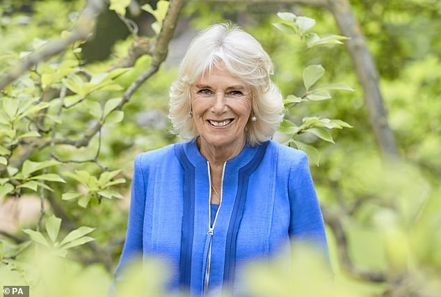 Duchess of Cornwall wore a blue dress by her favourite designer Anna Valentine for a new portrait by royal snapper Chris Jackson to mark her 73rd birthday