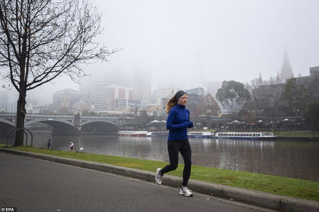 A woman runs along the Yarra River in Melbourne. The city has recently seen a spike in coronavirus cases in a second wave