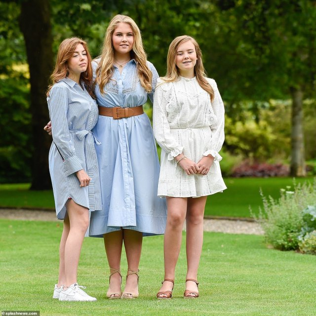 Sister act! The teenage princesses wore coloured nail polish - with Amalia (centre) picking a bold deep red while Alexia (right) paired her Tommy Hilfiger dress with a white manicure.  Meanwhile youngest Alexia opted for a nude nail and brown sandals