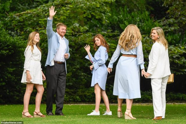 Over here! King Willem-Alexander let out his fun side as he joked and stretched up with photographers while middle sister Princess Alexia (centre), waved at camera and heir-apparent Amalia held hands with her mother (right)