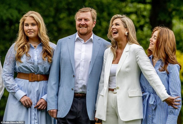 Family fun! Maxima let out a giant laugh as she posed and giggled with her family at the palace, posing her arm out onto her daughter Alexia who smirked in the pictures