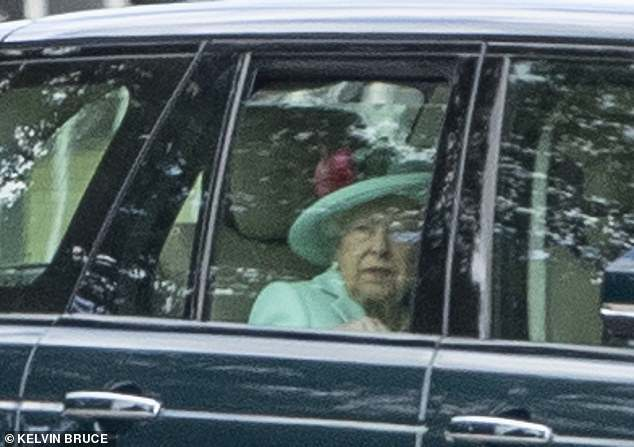 The Queen was dressed in a vibrant blue coat with matching hat for the wedding today