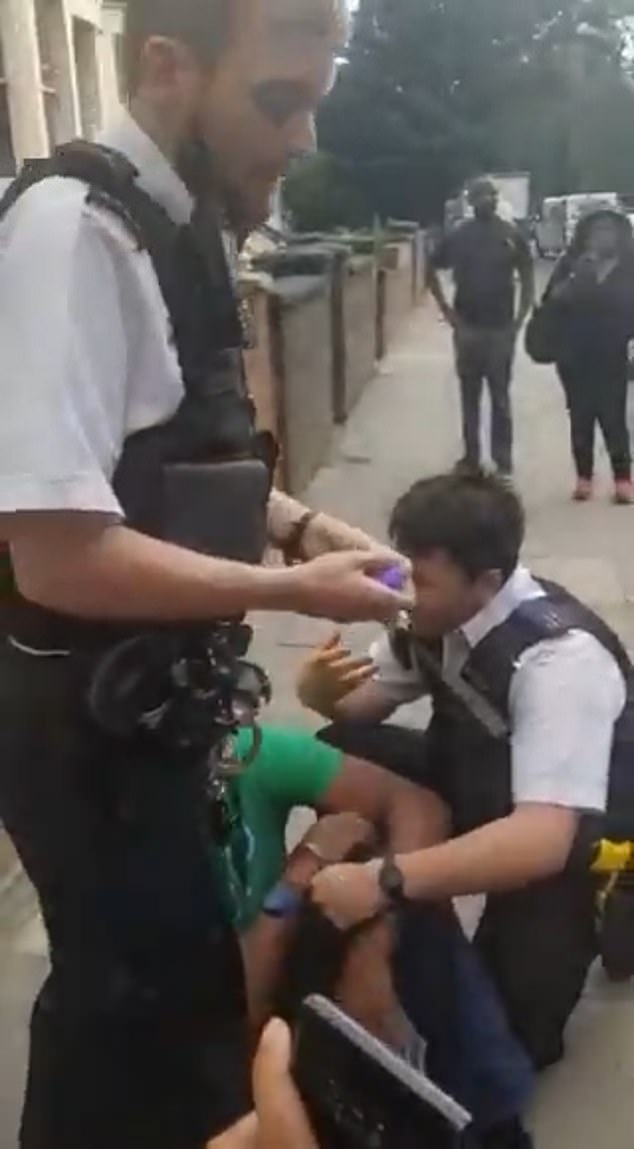 After several seconds, the officer takes his knee off the suspect before telling an onlooker to 'shut it' when they criticise his use of force