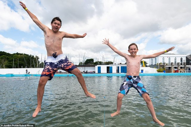 Lymington Sea Water Baths is the oldest and largest lido in the UK, and have reopened to the general public today. Pictured are brothers James, 16, and Myles, 12