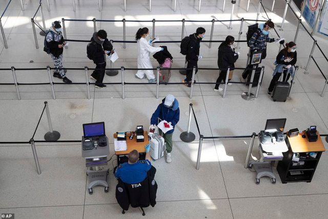 Passengers at JFK airport in New York in March. Trump issued a travel ban on China on February 2 but it was more than a month later on March 13 that he placed restrictions on people coming from Europe