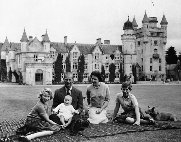 They holidayed in Balmoral back in 1960, with the Queen,Prince Philip and their children, Prince Charles, right, Princess Anne and Prince Andrew, seen here
