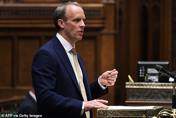 The Foreign Office is working on estimates that 200,000 Hong Kongers will take up the offer and move to the UK, according to the Financial Times (Pictured: Foreign Secretary Dominic Raab in the House of Commons to discuss China's controversial Security Law on July 1 2020)