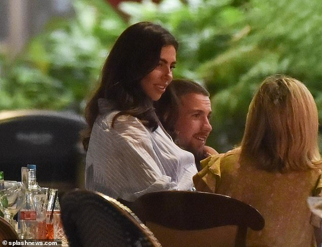 Cuddles: Francesca sat on his lap, walked hand-in-hand and even wandered off for a private chat with a glass of wine in hand