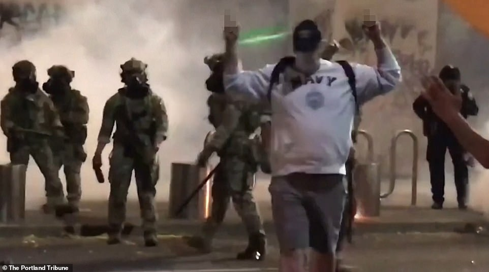 As the man starts to walk away, an officer hits him at least two more times before the protester threw his middle fingers in the air