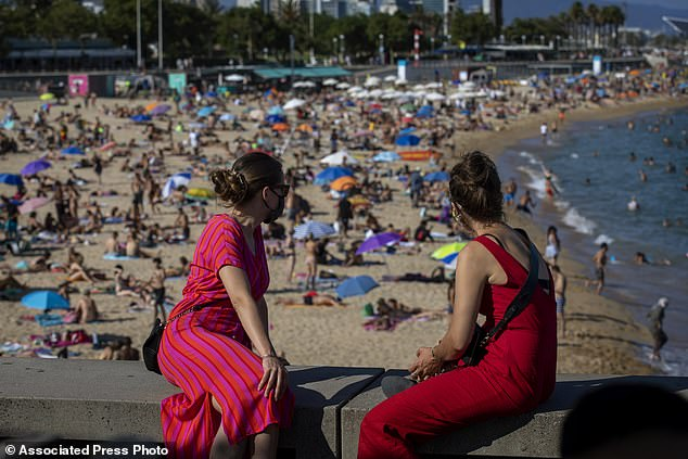 Police in Barcelona (crowds at the beach on July 18) have limited access to some of the city's beloved beaches because sunbathers were ignoring social distancing regulations amid a resurgence of coronavirus infections