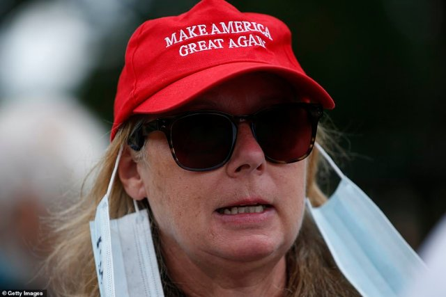 A demonstrator wears a Make America Great Again cap at the central London demonstration, organised by Keep Britain Free