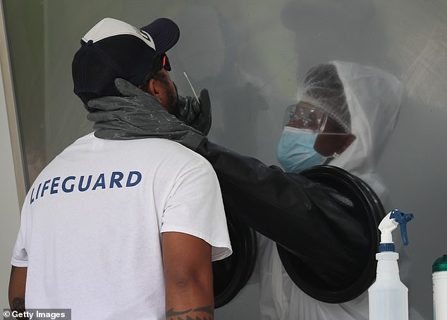 Infections have been soaring in US states such as Florida (testing site pictured), Texas, Arizona, with many blaming a haphazard, partisan approach to lifting lockdowns as well as the resistance of some Americans to wearing masks