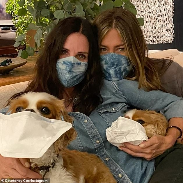 Instagram PSA: Saturday, Cox, 56, had shared a video of herself and Aniston huddled with her two dogs and the four wearing masks