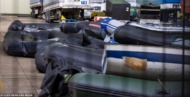 Battered boats and dinghies used for the dangerous trip across the Channel are pictured here at the facility in Dover, Kent