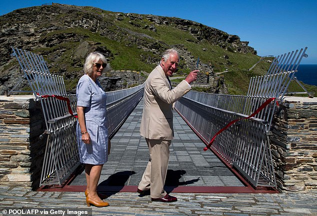 Prince Charles and Camilla appeared in high spirits as they soaked up the sunshine during a visit to Cornwall today