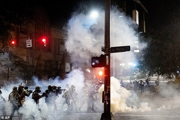 Portland police early Monday detailed another night of conflict between protesters and federal forces outside the US courthouse, including a small fire outside the building and tear gas deployed to disperse the crowd