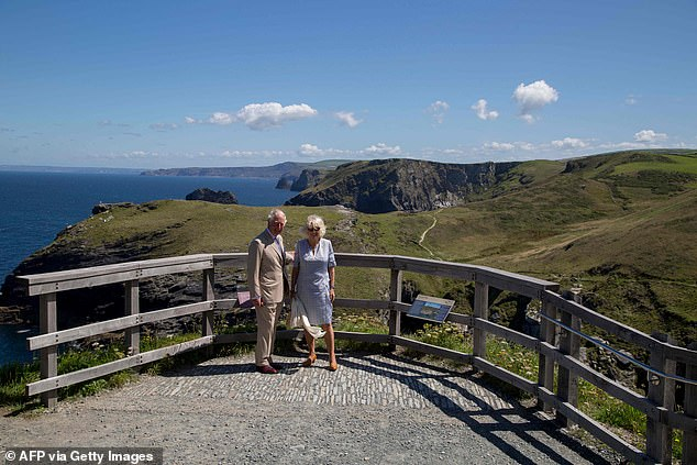 The couple posed for photographs as they took in the stunning views from a lookout point close to the ridge on Tintagel Castle island
