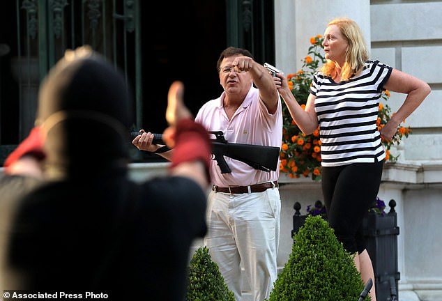 Missouri Governor Mike Parson called it 'outrageous' after the top prosecutor in St. Louis filed charges against Mark and Patricia McCloskey, who displayed weapons as a crowd marched past their mansion in protest of racial injustice on June 28