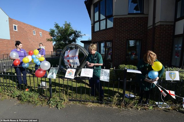 Balloons and tributes are installed by staff at Woodhorn Park Care Home in Ashington, Northumberland, this morning