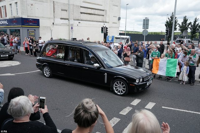 People line the streets as the funeral cortege of Jack Charlton passes through his hometown of Ashington this morning