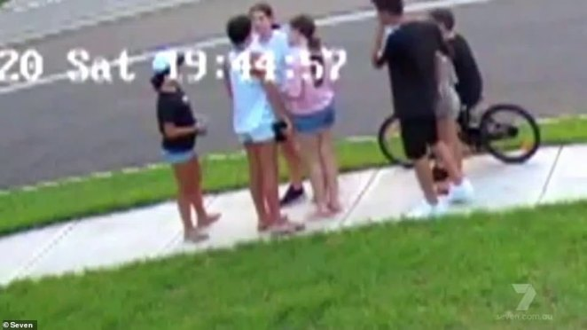 CCTV footage taken outside the home where the crash took place. The never-before-seen vision showed the children stopped in a circle and chatting animatedly on the sidewalk moments before disaster struck