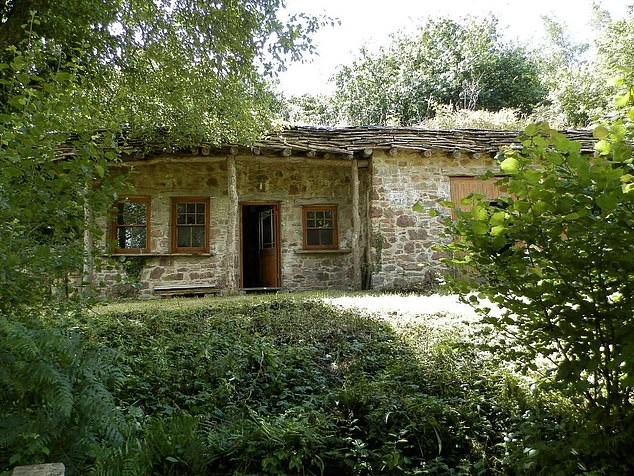 A stone workshop (pictured) can also be found within the 80-acre property only a short walk from the house