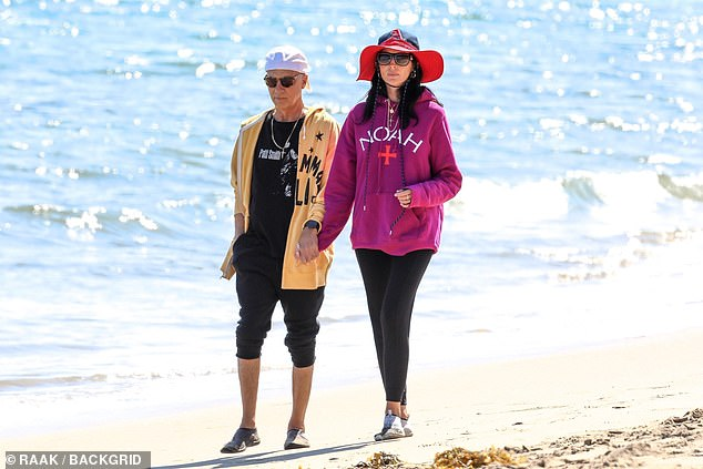 Keeping their distance from others: The 41-year-old English model and the legendary music executive, 67, both wore hats and hoodies for the outing, although in very different styles