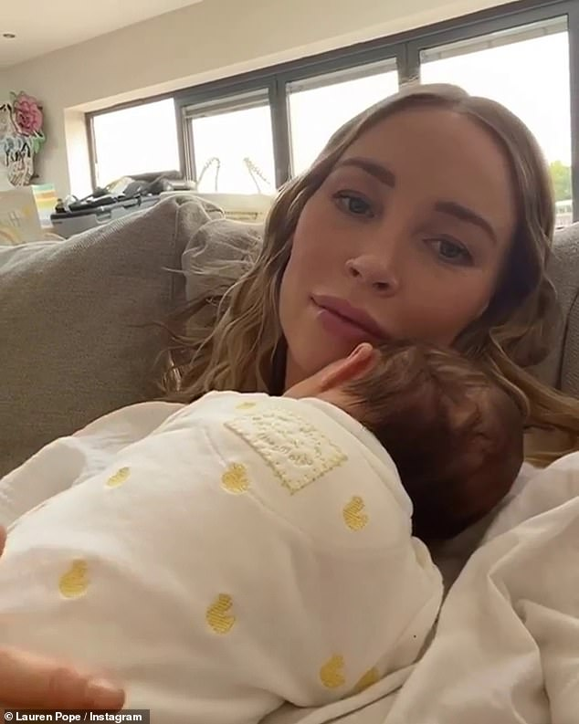 So sweet:The new mum looked simply radiant as she serenely gazed at the camera while stroking little Raine's back who was dozing peacefully on her mother's chest