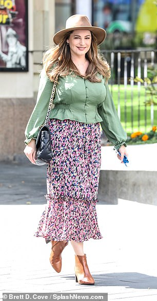 Boho:She completed the look with tan ankle boots and carried a black shoulder purse