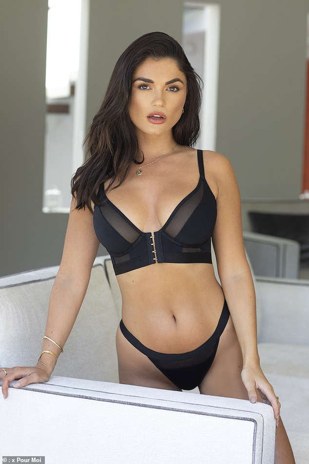 Inclusivity: The TV beauty put on a busty display in the matching black number and revealed that she has launched a lingerie collection that features 'super comfy' and 'super sexy' sets