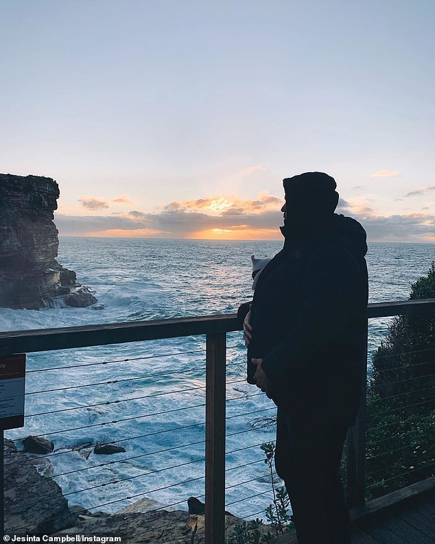 Peaceful stroll: Last week, the couple enjoyed a peaceful walk together with their baby girl along the coast in Sydney. Jesinta shared a photo of Buddy looking out at the sunrise, while strapped to his chest in a carrier was little Tullulah