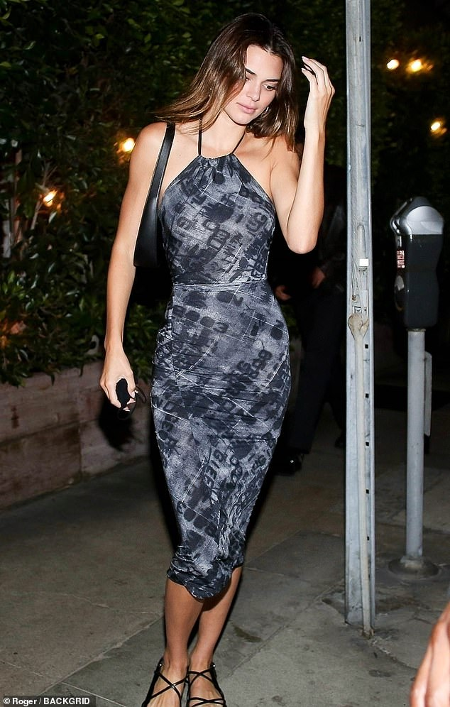 Turning heads: Kendall Jenner draped her slender figure into a skin-tight halter dress for an intimate dinner with her close friend, Fai Khadra, in Santa Monica on Thursday