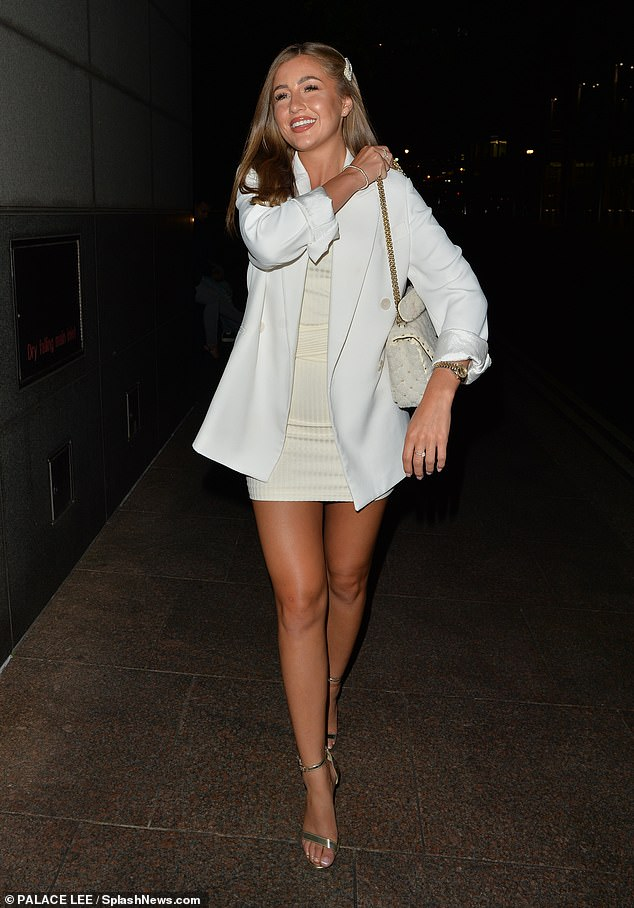 Looking good:Georgia ensured she had all eyes on her as she stunned in the thigh-skimming mini which allowed her to perfectly display her slender, bronzed pins