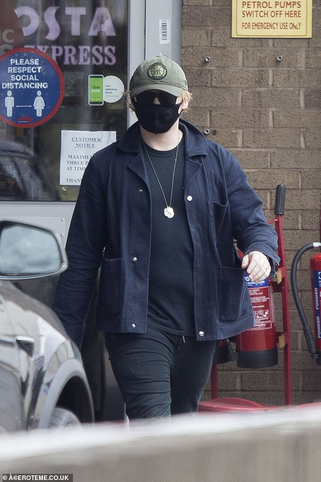 Staying safe:The Harry Potter star, 31, made sure to stay protected amid the coronavirus crisis as he wore a face mask during the outing